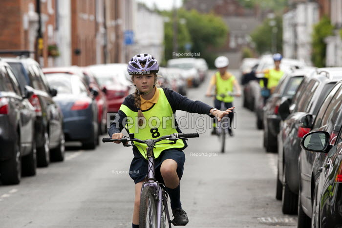 Pupils on a Cycle Proficiency training course on the roads around Broad Street, Stratford-upon-Avon Primary School, Warwickshire - John Harris - 2015-06-17