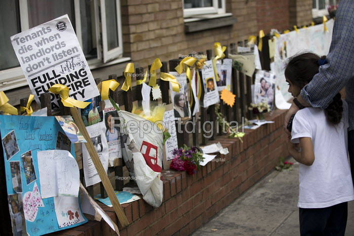 Floral tributes and the missing posters of the victims Grenfell Tower Fire, West London. - Jess Hurd - 2017-06-22