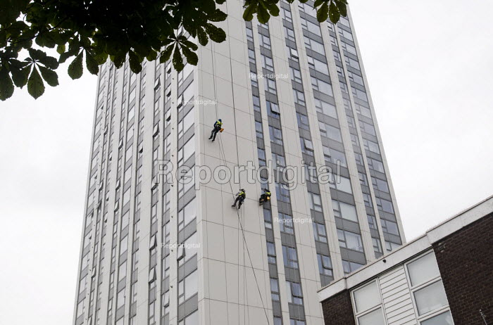 Contractors inspecting external panels on Bray Tower one five towers in Chalcot Estate, Camden, London, all of which have been refurbished using exterior cladding which now has to be urgently replaced as it is proven unsafe following the Grenfell Tower Fire - Stefano Cagnoni - 2017-06-27