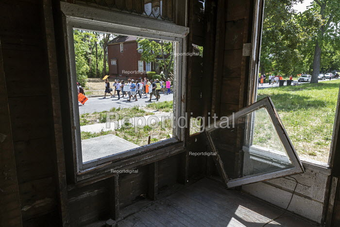 Detroit, Michigan USA Protest at the lack of support for city neighborhoods where mortgage and tax foreclosure have left houses empty. Residents are now threatened by gentrification of parts of their community - Jim West - 2017-07-08