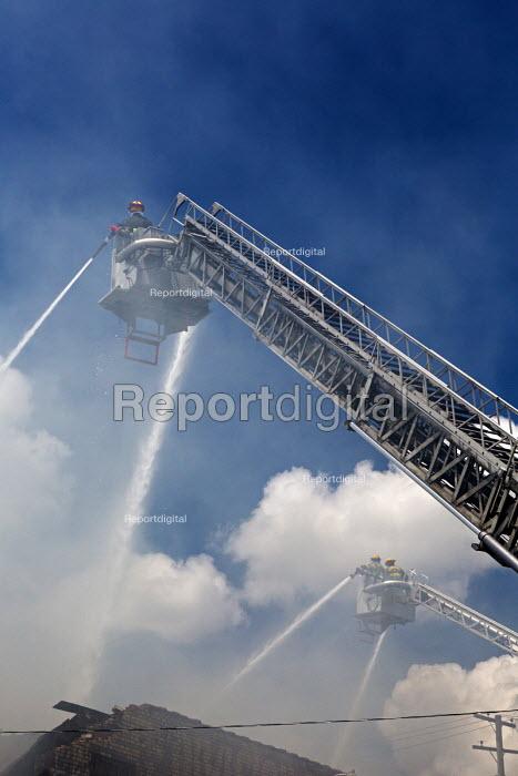 Detroit, Michigan, USA Firefighters firefighting a warehouse fire - Jim West - 2017-07-08