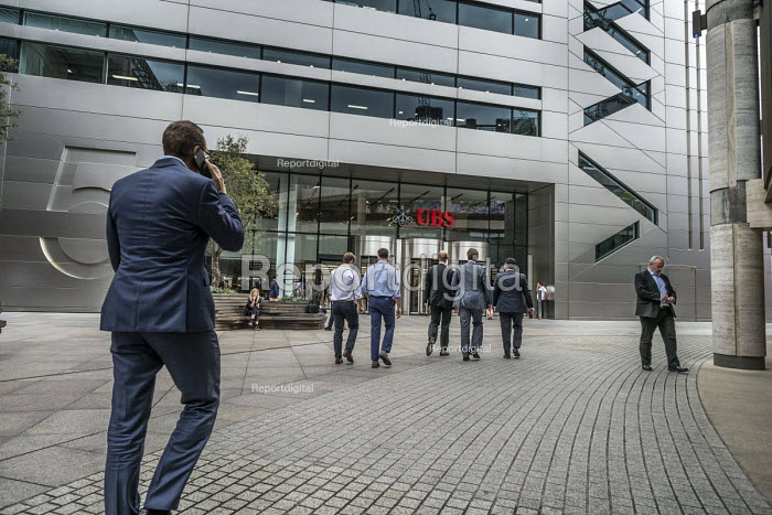 Bankers return to work at UBS Bank after their lunch break. Broadgate Circle, part of a privately owned and managed public space around Liverpool Street station, London - Philip Wolmuth - 2017-07-28