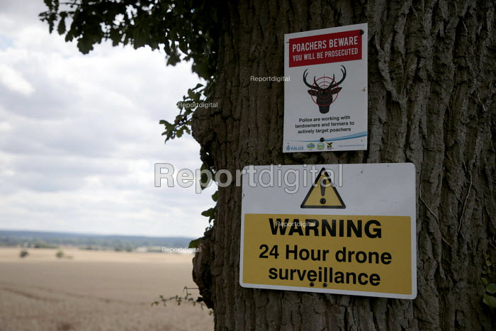 Signs warning of 24 hour drone surveillance and poachers beware you will be prosecuted, farm in Wawickshire - John Harris - 2017-08-10
