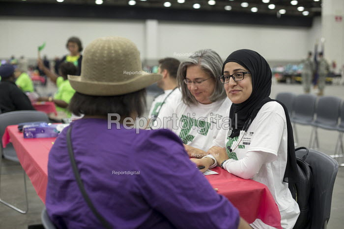 Detroit, Michigan USA Volunteer nurse practitioners from Eastern Michigan University talking to a patient, Motor City Medical Mission, a free three day medical clinic sponsored by the Adventist Medical Evangelism Network - Jim West - 2017-08-09