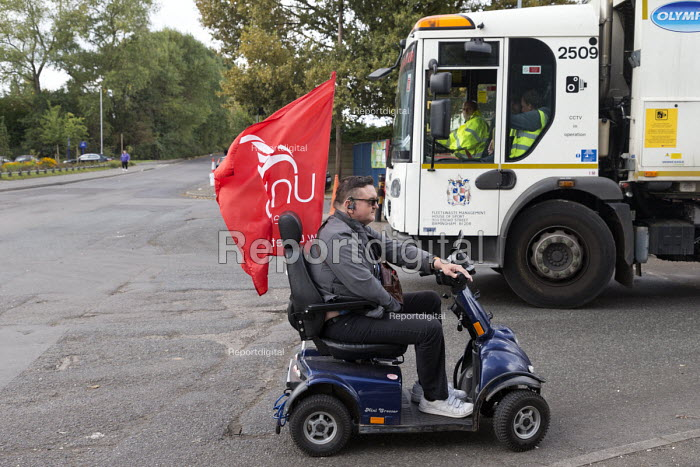 Disabled supporter, Birmingham council refuse workers go on strike against redundancies, Perry Barr Depot, Birmingham. Birmingham City Council want to save 600,000 a year by axing 113 grade three bin men and replacing them with lower paid positions. - John Harris - 2017-09-01