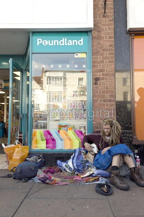 Homeless young man begging and pet dog on the pavement outside Poundland, Stratford upon Avon, Warwickshire - John Harris - 2017-09-02