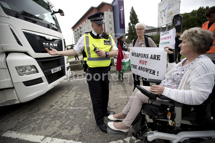 Celia Davies, veteran Quaker peace campaigner who had her neck broken by the police at Greenham Common. Stop DSEi arms fair protest prevents vehicle entering ExCel centre London Stop Arming Israel. Defence Security and Equipment International exhibition - Jess Hurd - 2017-09-04