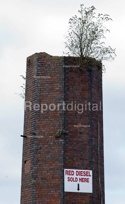 Red Diesel Sold Here, sign on an old factory chimney with a buddleia growing out of it, Saltley Birmingham - John Harris - 2017-09-17