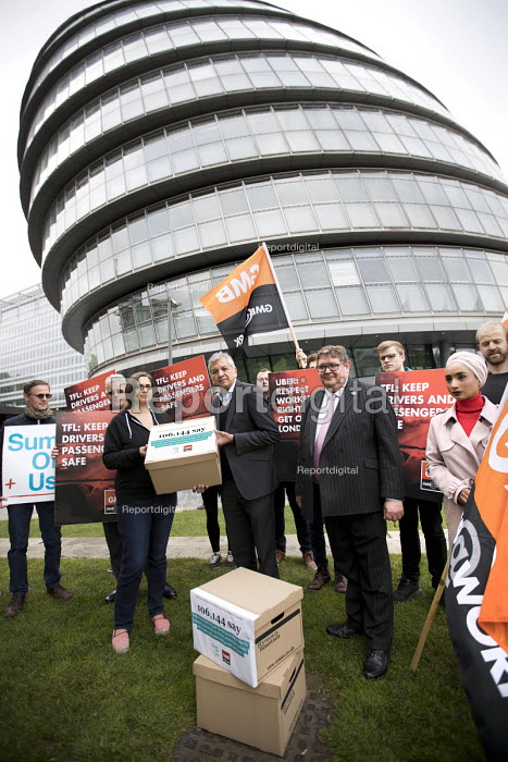 GMB and SumOfUs petition Transport For London against renewal of the Uber operating licence, drivers rights and protecting the public, City Hall, London. Handing in the petition to Labour London Assembly Member Unmesh Desai. The petition has more than 106,000 signatures - Jess Hurd - 2017-09-18