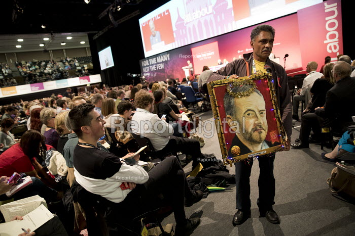 Artist Kaya Mar with painting of Jeremy Corbyn with a halo, Labour Party Conference, Brighton 2017 - Jess Hurd - 2017-09-25