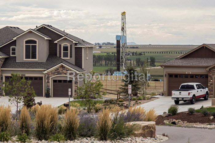 Berthoud, Colorado - A fracking rig near new homes at the corner of Tranquility Way and Serenity Ridge Parkway in Weld County. - Jim West - 2017-08-24