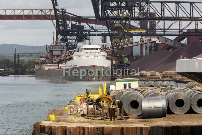 Sault Ste. Marie, Ontario Canada Steel rolls on the dock, Algoma steel mill on the shore of the St. Marys River. Bulk cargo carrier Michipicoten delivering taconite - Jim West - 2017-09-05