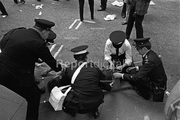 St Johns Ambulance men treating Kevin Gately who died from a fatal injury to the head, 1974 Red Lion Square confrontation between police and demonstrators who were trying to stop the National Front from holding a meeting at Conway Hall, London - NLA - 1974-06-15