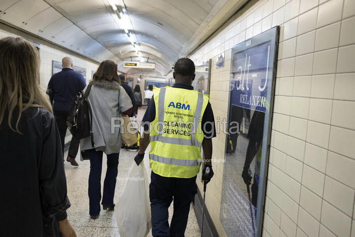 ABM Cleaning Services contract worker, Bond Street tube station, London - Philip Wolmuth - 2017-09-19