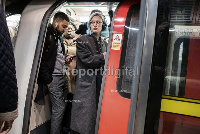 Woman passenger, crowded rush hour tube train, London Bridge underground station - Philip Wolmuth - 2017-10-04