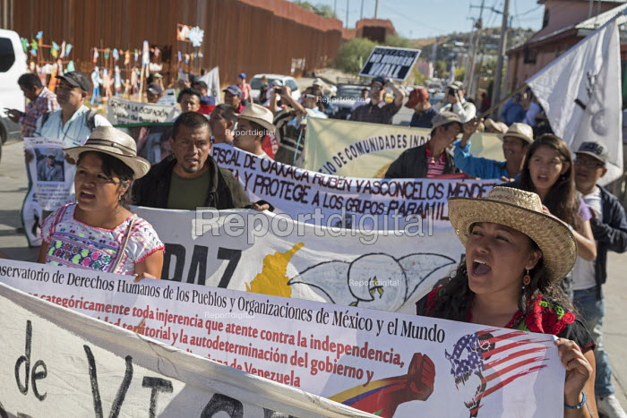 Nogales, Arizona USA Protest on both sides of the US Mexican border fence for more open immigration. Organized by the School of the Americas Watch, a group of religious and community activists - Jim West - 2017-11-11