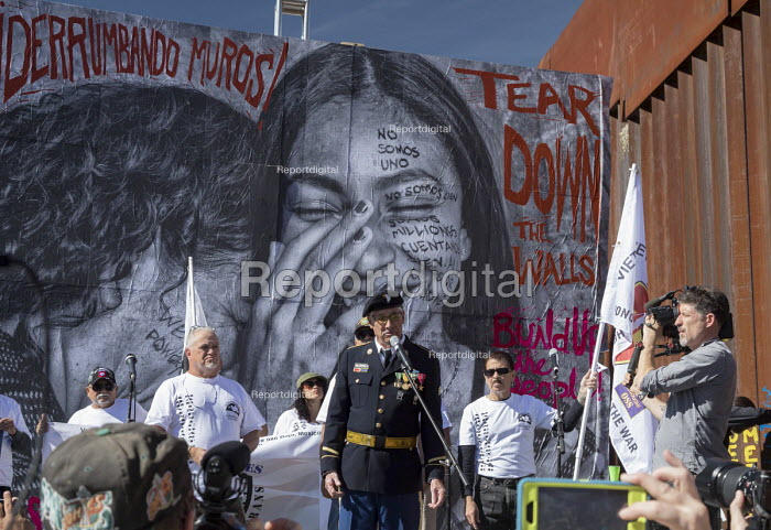 Nogales, Arizona USA Veterans for Peace, protest on both sides of the U.S. Mexican border fence against the separation of immigrant families, U.S. policies that make it hard for refugees fleeing repression to enter the United States and the deportation of veterans who have served in the U.S. military. The events were organized by the School of the Americas Watch, a group of religious and community activists - Jim West - 2017-11-11