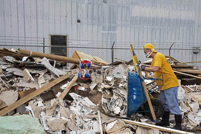Humble Texas USA Volunteers clearing up Hurricane Harvey flood damage to the Mana Family Worship Center. The workers are from the Southern Baptist Convention Oklahoma - Jim West - 2017-11-02