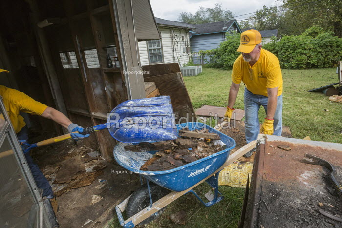 Humble Texas USA Volunteers clearing up Hurricane Harvey flood damage to the Mana Family Worship Center. The workers are from the Southern Baptist Convention Oklahoma - Jim West - 2017-11-01
