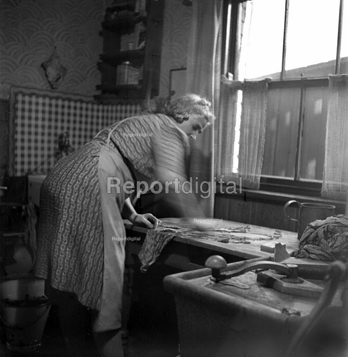 Miners wife washing clothes in the kitchen, Easington 1948 - Elisabeth Chat, RAEC4835.jpg