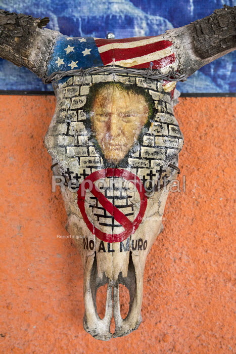 Boquillas del Carmen, Coahuila, Mexico, an image of President Donald Trump embedded in a longhorn skull with a slogan opposing a border wall on the wall of the Boquillas Restaurant - Jim West - 2017-11-05