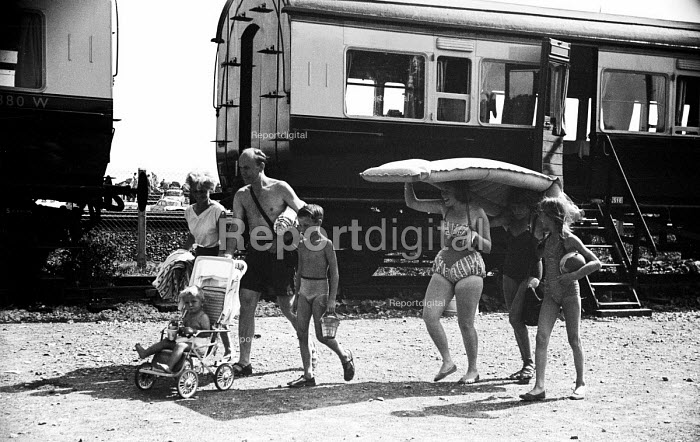 Devon 1959 family on summer holiday leaving their Camping Coaches, disused train carriages converted for holiday use, for the nearby beach - Alan Vines - 1959-08-13
