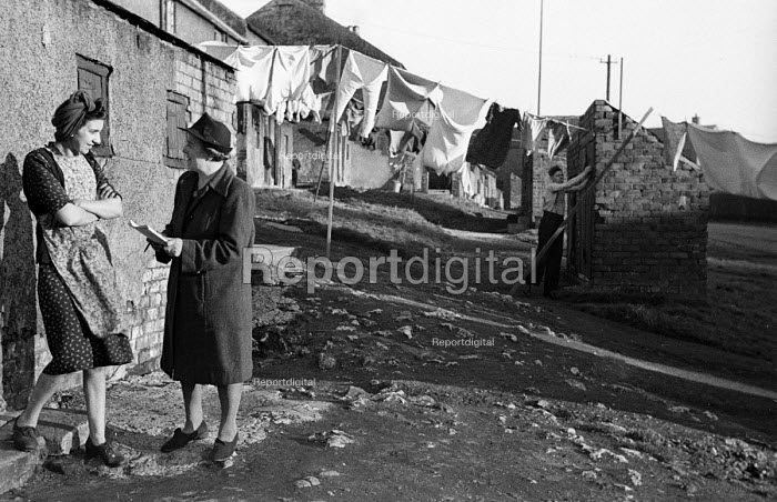 Woman from Easington Rural District Council conducting survey with miners wife Shotton in County Durham 1948. The local new town of Peterlee emerged from the New Towns Act following pressure from the District Council to create better living conditons for mining familes such as these - Elisabeth Chat - 1948-06-01