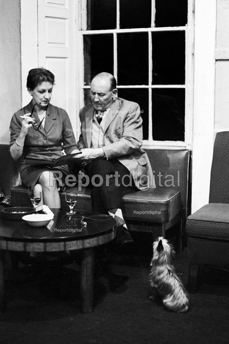 Patrons with their dog in the bar of the Traverse Theatre Edinburgh 1965 a radical arts venue seeking to extend the spirit of the Edinburgh Festival throughout the year - Patrick Eagar - 1965-08-04