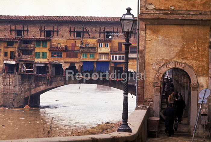 Florence Floods, Italy, 1966. Ponte Vecchio bridge over the Ano. The floods in Florence in early November were the worst in over five hundred years and resulted in the loss of over 100 Florentine lives as well as damage to thousands of cultural artefacts, including ancients books, paintings and sculptures. - Romano Cagnoni - 1966-11-11