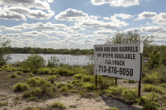 Tilden, Texas, USA Sign offering water for sale from Rancho Tres Hijos for fracking in oilfield operations in the surrounding Eagle Ford Shale. Rancho Tres Hijos is a cattle and hunting ranch - Jim West - 2017-11-14