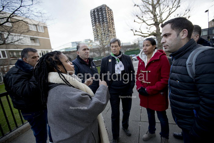 Palestinian firefighters visiting Grenfell meeting Judy from Justice for Grenfell in a solidarity. The firefighters have been training in Scotland with the support of the FBU and Scottish Government. Kensington, London - Jess Hurd - 2018-01-19