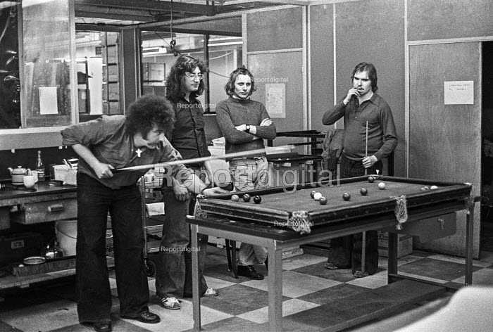 Workers occupy Crosfield Electronics, Holloway, London 1975, playing pool during an occupation to keep their jobs in London. Crosfields developed the first digital scanner for the printing industry in the mid 1970s - Martin Mayer - 1975-03-31