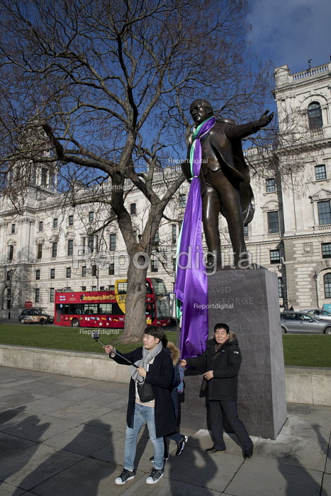 David Lloyd George statue draped in the Suffragette flag to celebrate the centenary of womens suffrage, Parliament Square, London - Jess Hurd - 2018-02-06