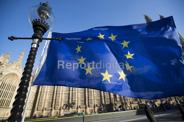 EU flag flies outside the Houses of Parliament, Westminster, London. - Jess Hurd - 2018-02-06