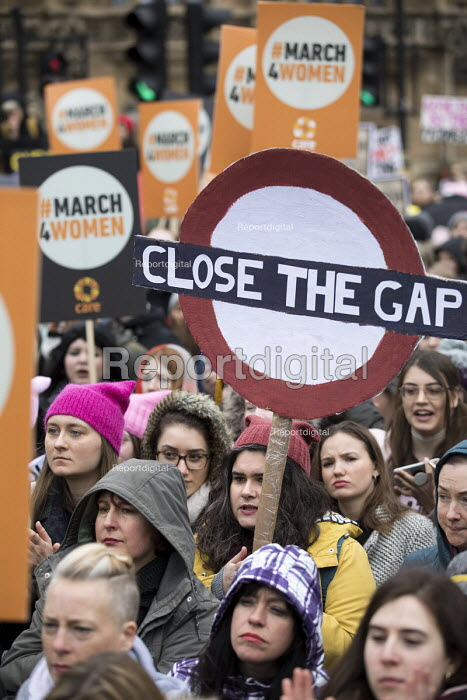 March4Women retracing the historic steps of the suffragettes past Parliament to Trafalgar Square organised by CARE International UK, Westminster, London. Close the Gap for equal pay - Jess Hurd - 2018-03-04