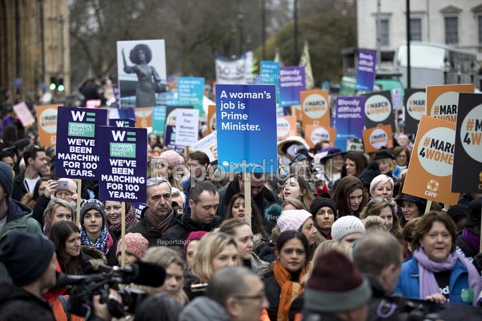 Conservative Party placard, March4Women retracing the historic steps of the suffragettes past Parliament to Trafalgar Square organised by CARE International UK, Westminster, London. - Jess Hurd - 2018-03-04
