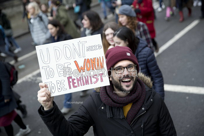 March4Women retracing the historic steps of the suffragettes past Parliament to Trafalgar Square organised by CARE International UK, Westminster, London. A male feminist - Jess Hurd - 2018-03-04