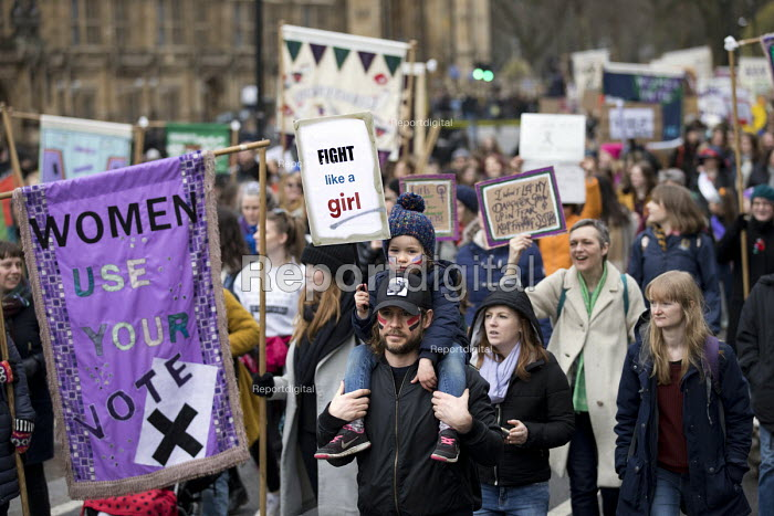 Fight like a girl placard joins March4Women retracing the historic steps of the suffragettes past Parliament to Trafalgar Square organised by CARE International UK, Westminster, London. - Jess Hurd - 2018-03-04