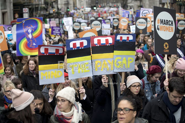 March4Women retracing the historic steps of the suffragettes past Parliament to Trafalgar Square organised by CARE International UK, Westminster, London. Mind the Pay Gap for equal pay - Jess Hurd - 2018-03-04