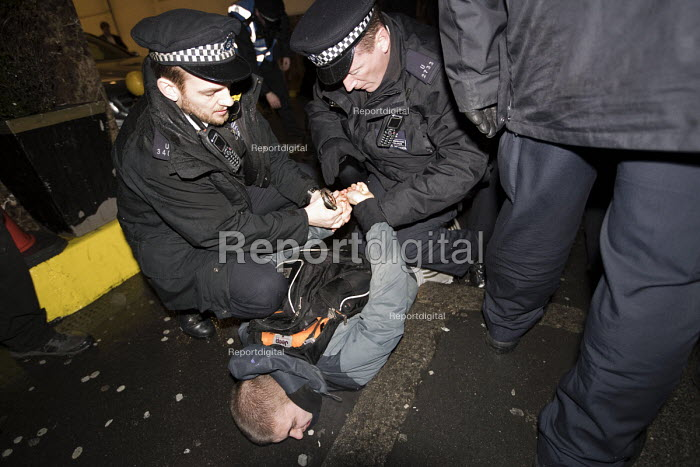 Police arresting Anti fascist protester outside a secret meeting of Jobbik, a far right Hungarian political party, South Kensington, London - Jess Hurd - 2018-03-09