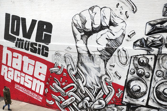 Mural by graffiti artist Snub23 promoting unity, Love Music Hate Racism, Stand up to Racism, Shoreditch, London, prior to the March Against Racism on United Nations Anti Racism Day - Jess Hurd - 2018-03-13