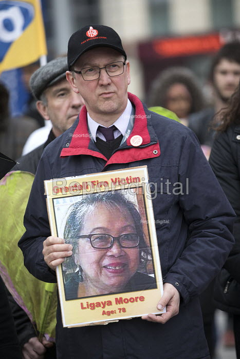 Silent protest for Grenfell Tower victims, Bristol. Protesters holding placards showing pictures of those who had died - Paul Box - 2018-03-14