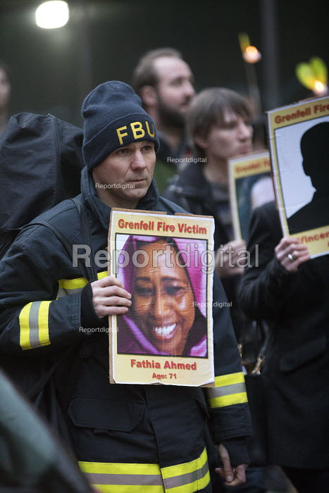 Trevor French FBU.Silent protest for Grenfell Tower victims, Bristol. Protesters holding placards showing pictures of those who had died - Paul Box - 2018-03-14