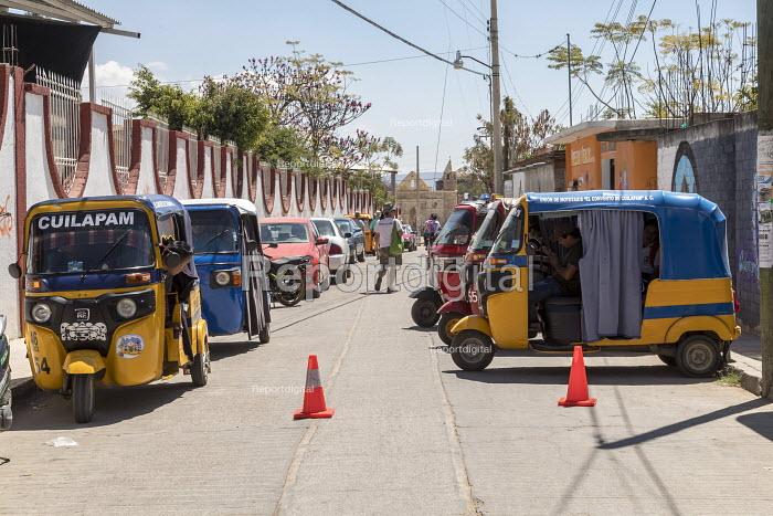 Cuilapam de Guerrero, Oaxaca, Mexico Three wheeled city taxis made by the Indian company Tata Motors - Jim West - 2018-02-23