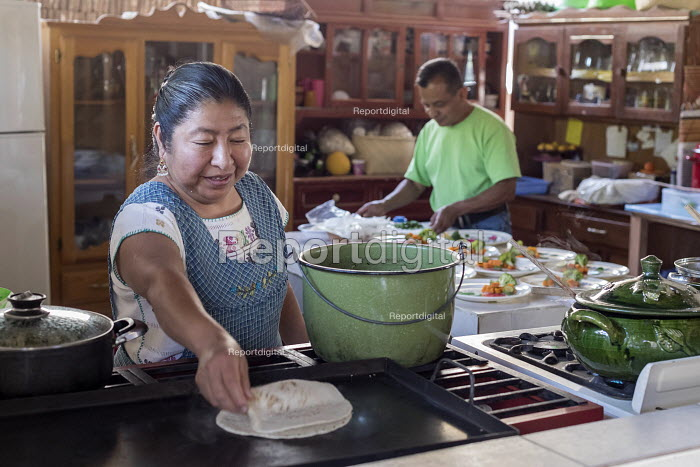 Teotitlan del Valle, Oaxaca, Mexico, Mexican women working in her restaurant, Comedor Jaguar. Microfinance loans from the non profit En Via are supporting small businesses in the village - Jim West - 2018-02-24