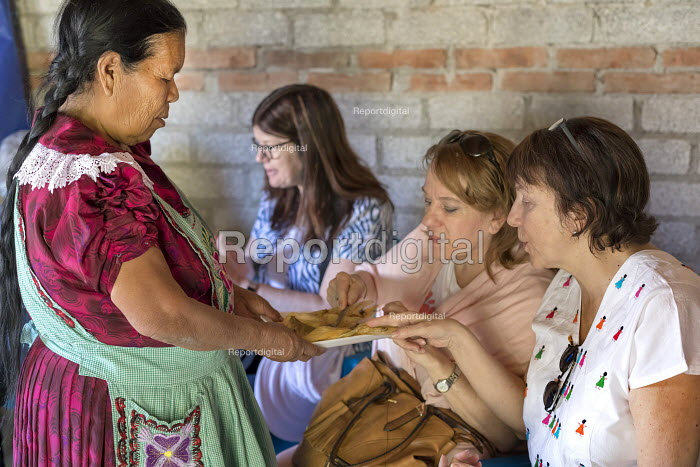 San Miguel del Valle, Oaxaca, Mexico, Woman serving tourists touring the En Via projects. Microfinance loans from the non profit En Via are supporting small businesses in the village - Jim West - 2018-02-24