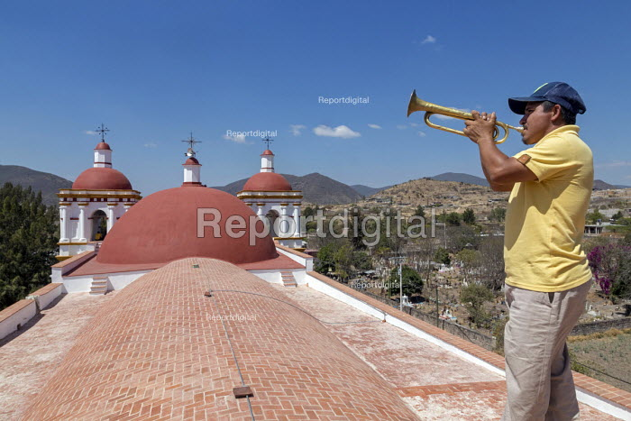 San Juan Teitipac, Oaxaca, Mexico Man playing a bugle on the roof of the 16th century Dominican church in a small Zapotec town - Jim West - 2018-02-22