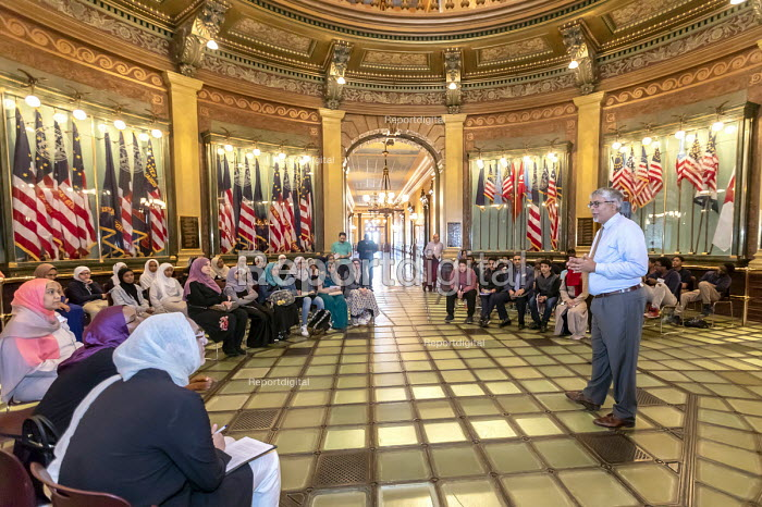 Lansing, Michigan, USA: Muslim high school students talking with Democratic State Representative Sam Singh in the state capitol rotunda. Annual Michigan Muslim Capitol Day - Jim West - 2018-05-09