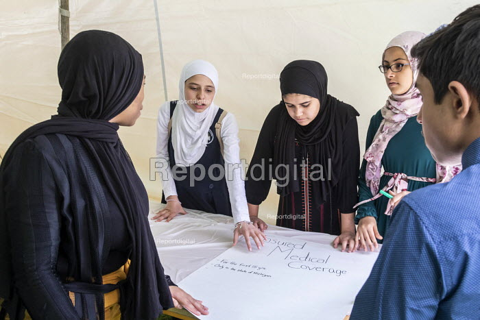 Lansing, Michigan, USA- Muslim high school students discussing legislation they would like the legislature to pass. Annual Michigan Muslim Capitol Day - Jim West - 2018-05-09