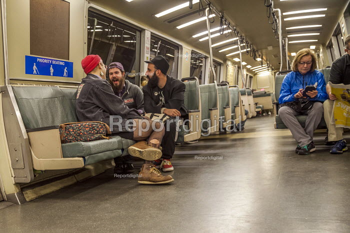 San Francisco, California, USA: Passengers on the Bay Area Rapid Transit train between San Francisco and Oakland as they go through the tunnel beneath San Francisco Bay - David Bacon - 2018-01-20